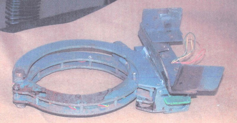 Triple-banded metal collar that was locked around Wells's neck.